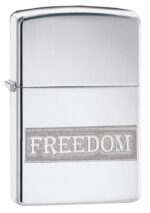 Etched Freedom Design High Polish Chrome windproof lighter facing forward at a 3/4 angle